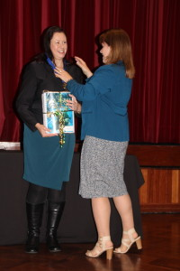 Sandra Robertson presents Kate Forsyth with a braille copy of her book.
