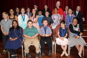 A group of vision impaired students wearing braille medals.